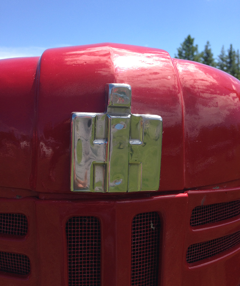 One of the marks of a good icon is it's versatility in different mediums. This International Harvester logo stands up in one-color metal.