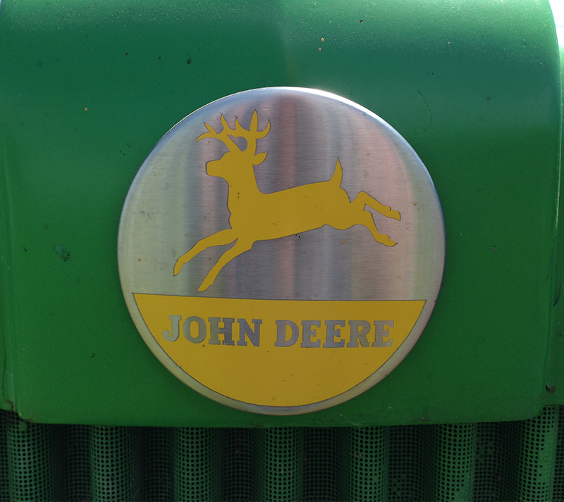 The John Deere logo has been consistent for many years, with only slight updates and modifications. (I took note of the direction of the deer's jump,  which changed in 2000).